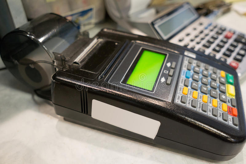 Credit Card Reader. Credit card machine reader on a counter of a restarant stock photo