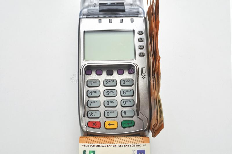 Credit card reader with money.Electronic money and cash stock image