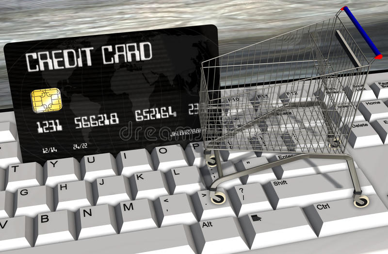 Credit card and shopping carts on computer keyboard closeup royalty free stock image