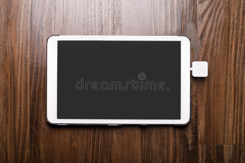 Credit Card Swipe Reader. Credit card payment on a swipe or chip reader app on a tablet used by small or online businesses. The electronic device is used as a royalty free stock photography