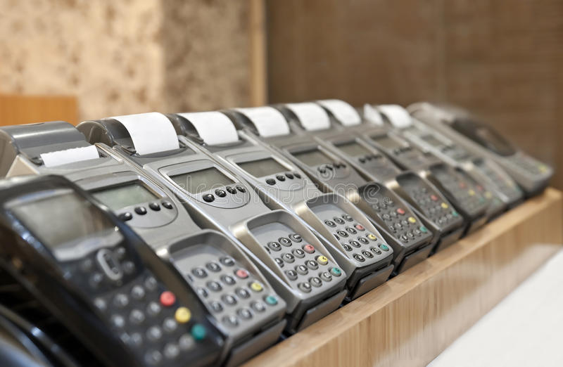Credit Card Terminals. Horizontal photo of many credit card POS terminals. The picture symbolizes extreme credit card usage stock photography
