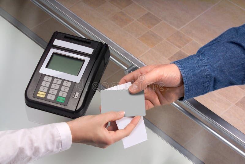 Credit card transaction. Between customer and clerck royalty free stock image