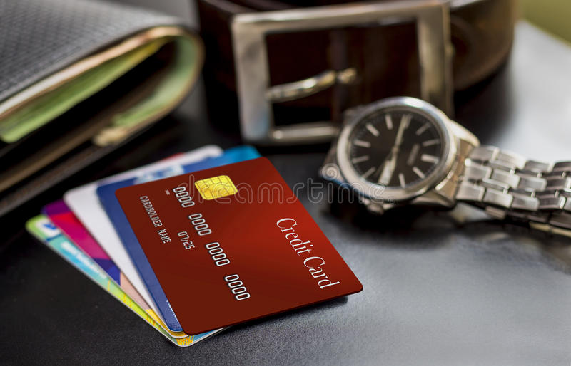 Credit card, wallet, watch and belt on the table, prepared to work or trip. Closeup of credit card, wallet, watch and belt on the table, prepared to work or stock photo