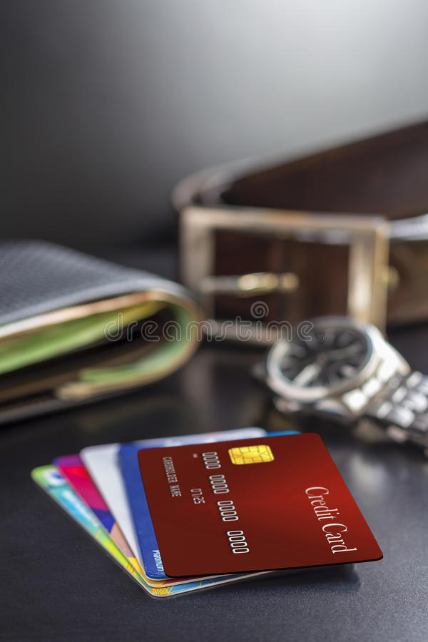 Credit card, wallet, watch and belt on the table, prepared to work or trip. royalty free stock image