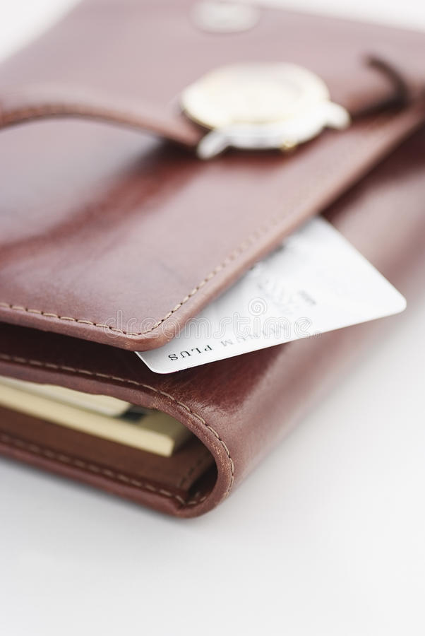 Credit card and a watch on a agenda. Business background stock photography