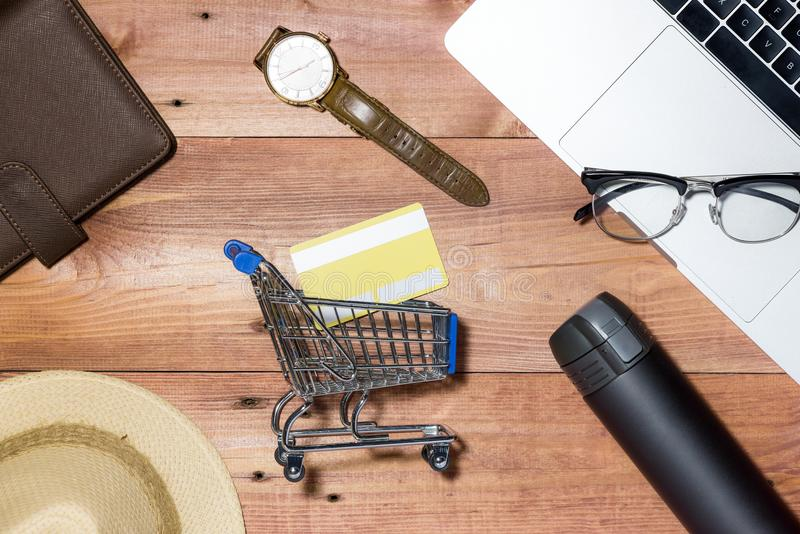 Credit card, watch, smartphone and coffee cup on wooden table.  stock photos