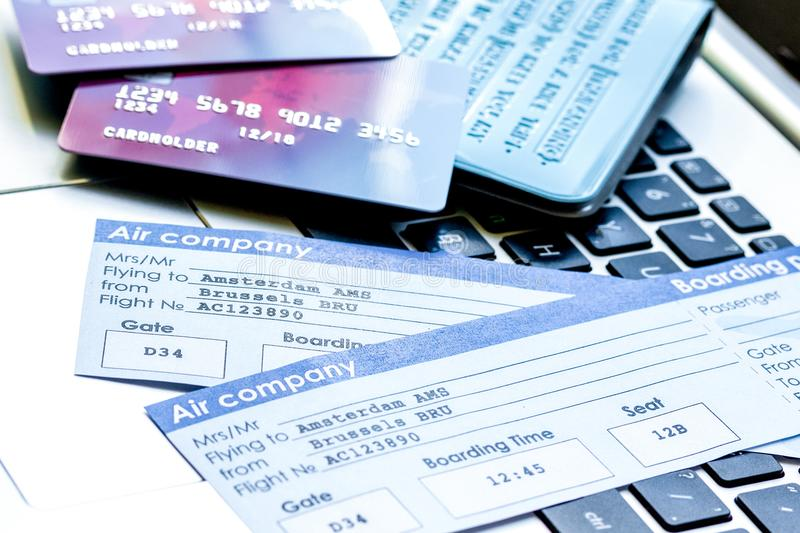 Credit cards with airline tickets for vacations on laptop backgr. Credit cards with airline tickets for vacations on laptop keyboard background stock photos