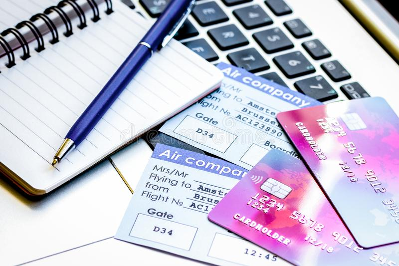 Credit cards with airline tickets for vacations on laptop backgr. Credit cards with airline tickets for vacations on laptop keyboard background royalty free stock photo