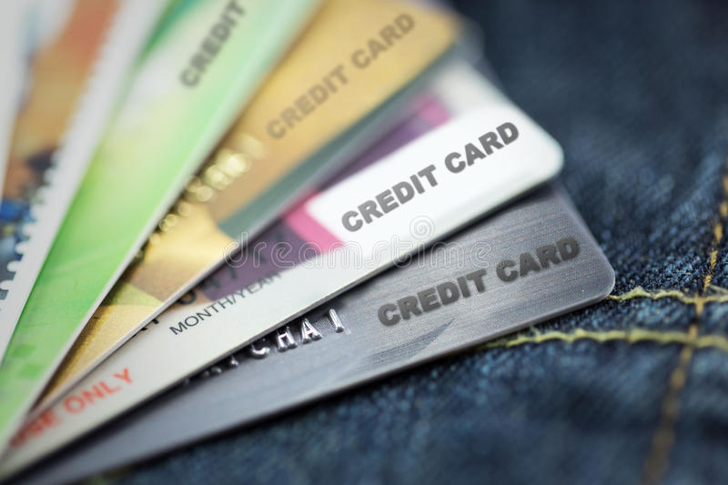 Credit cards on blue jeans texture stock photo