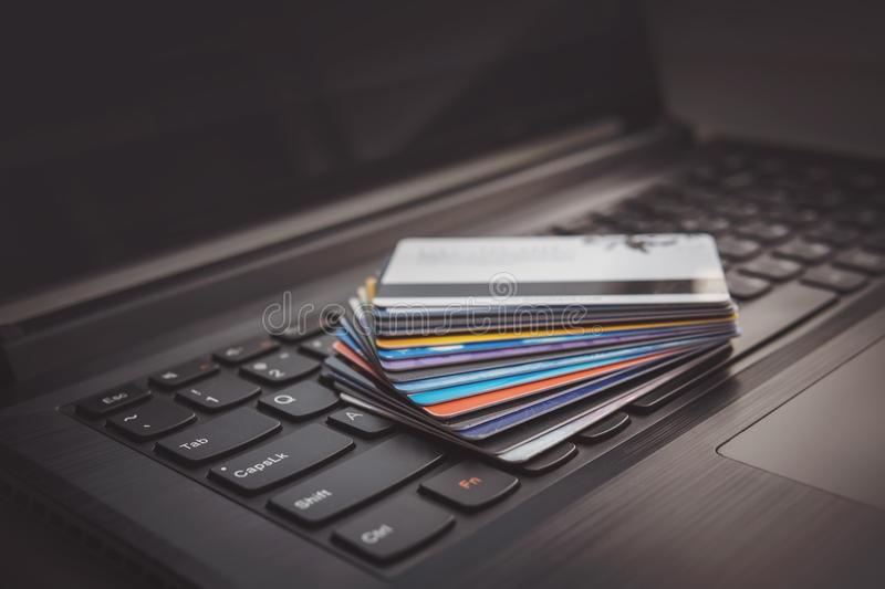 credit cards on computer keyboard stock images