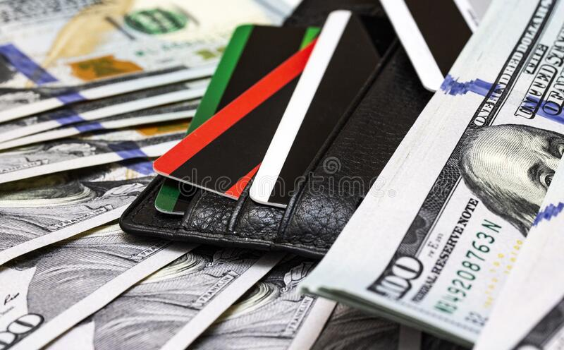 Credit cards and dollars in cash with credit cards royalty free stock photos