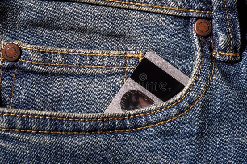 Credit cards in jeans pocket royalty free stock image