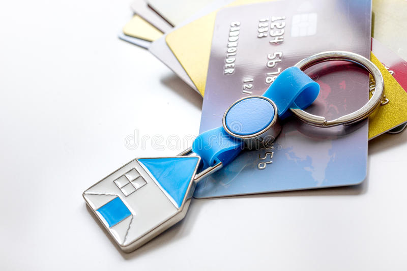 Credit cards, key ring - concept mortgage on white background.  stock photo