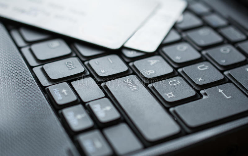 Credit cards on keyboard. Credit cards on a keybord of a laptop royalty free stock photography