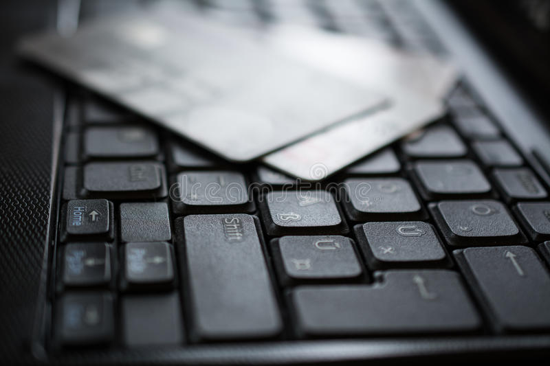 Credit cards on keyboard. Credit cards on a keybord of a laptop royalty free stock images