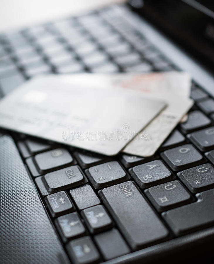 Credit cards on keyboard. Credit cards on a keybord of a laptop royalty free stock photo