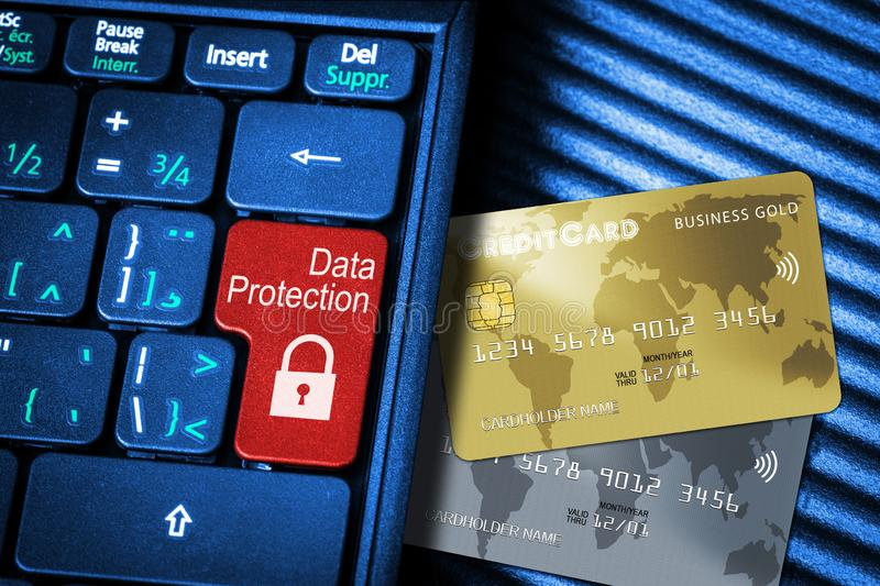 Credit Cards and Keyboard With Red Button Data Protection Concept. Close up of computer laptop keyboard on generic credit cards with red button Data Protection stock image