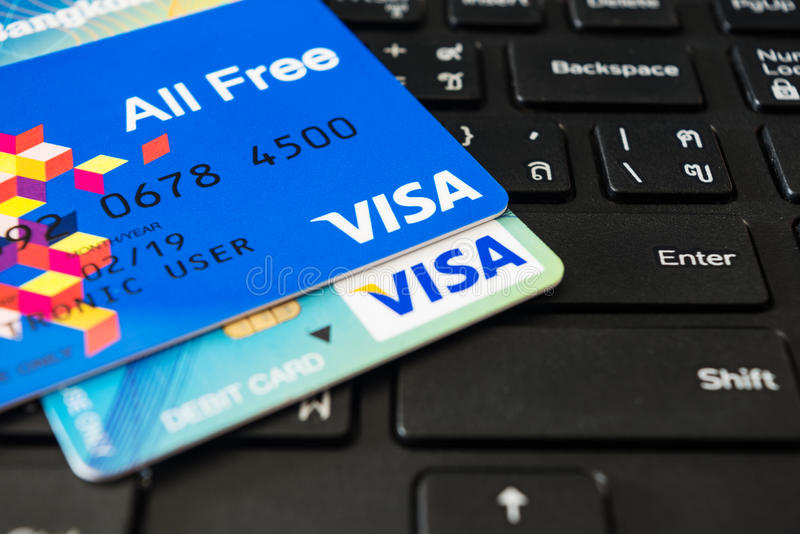 Credit cards lying on laptop royalty free stock images