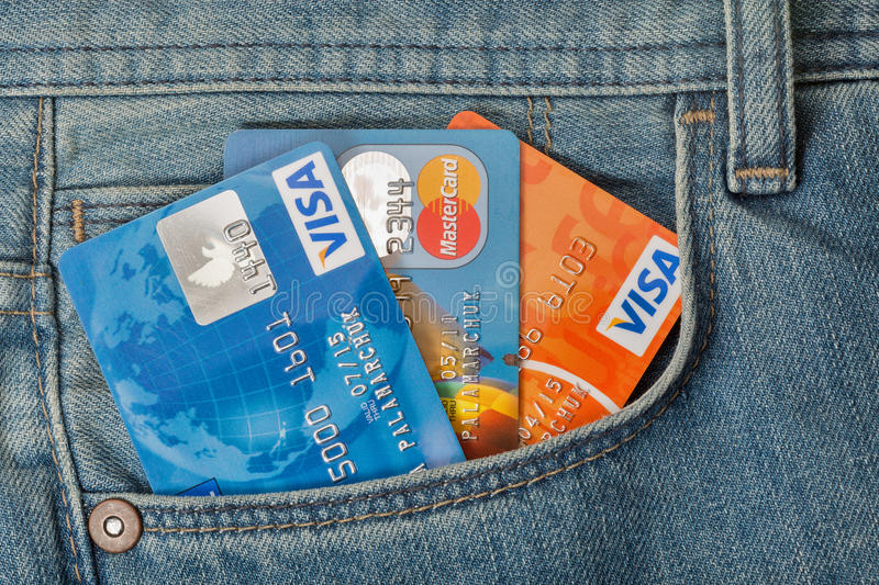 Credit cards in pocket of blue jeans closeup royalty free stock photo