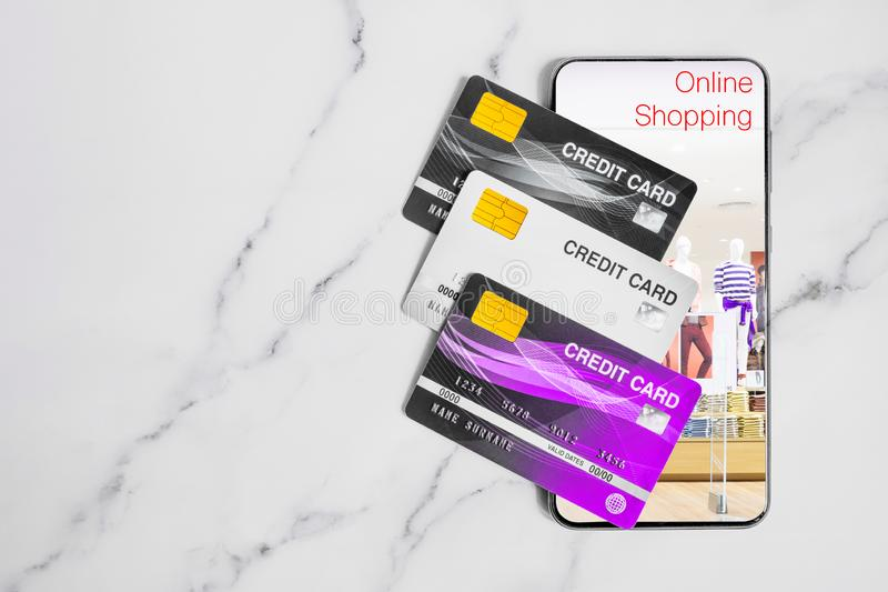 Credit card and smartphone on marble table for online shopping concept. Credit cards and smartphone on marble table for online shopping concept royalty free stock photos