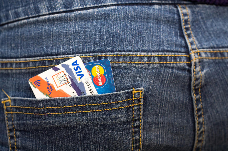 Credit cards Visa payWave and Mastercard in the back pocket of jeans stock image