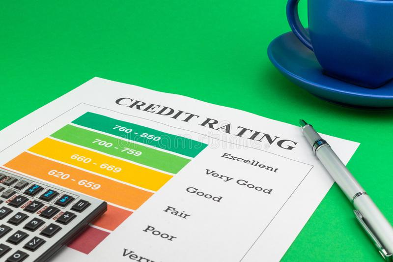 Credit rating on a green table, pen and calculator stock photography