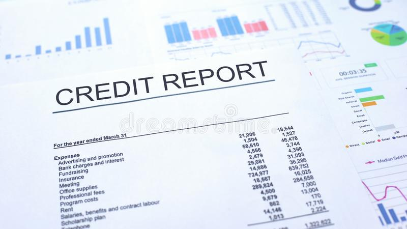 Credit report lying on table, graphs charts and diagrams, official document. Stock photo stock images