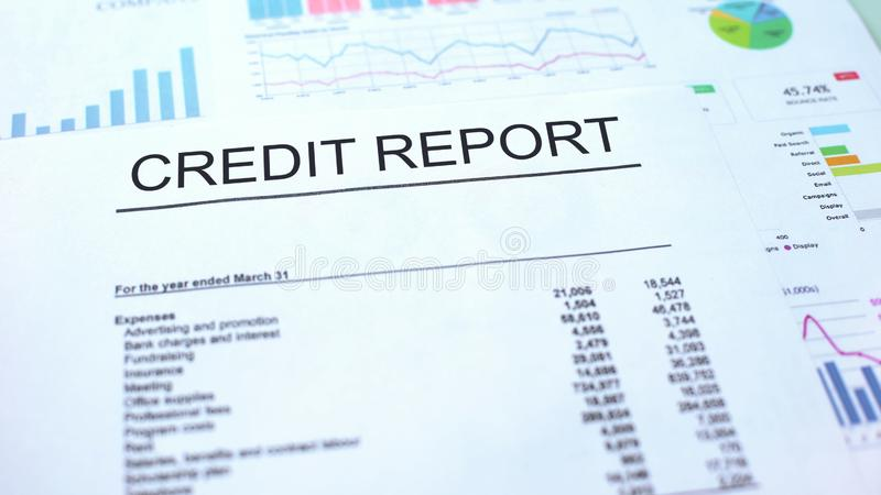 Credit report lying on table, graphs charts and diagrams, official document. Stock photo royalty free stock photography