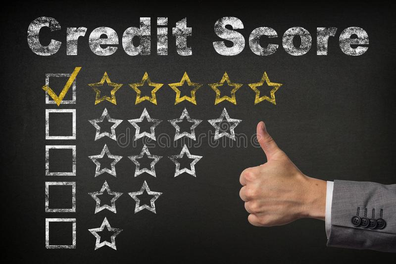 Credit score five 5 star rating. thumbs up service golden rating stars on chalkboard royalty free stock photo