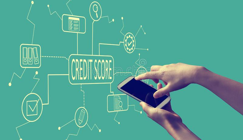 Credit score theme with person holding smartphone royalty free stock image