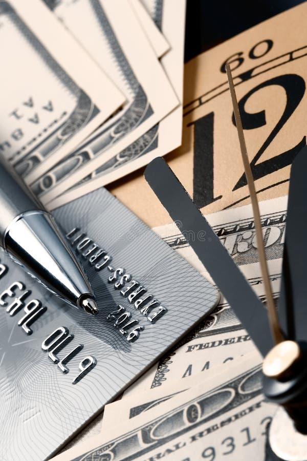 Creditcard, tijd en dollarscontant geld royalty-vrije stock foto's