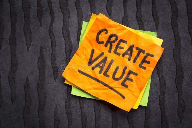 Cree el recordatorio del valor en nota pegajosa foto de archivo