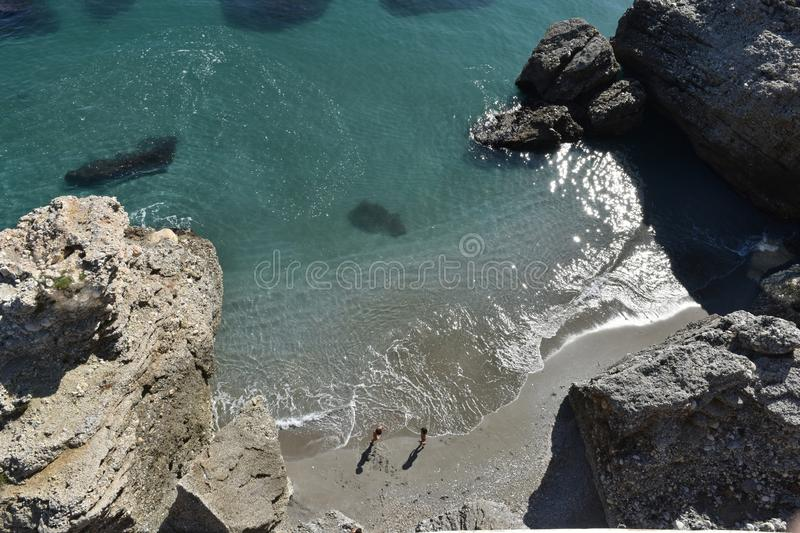 Creek with fine sand beach caressed by waves of sea water stock photo