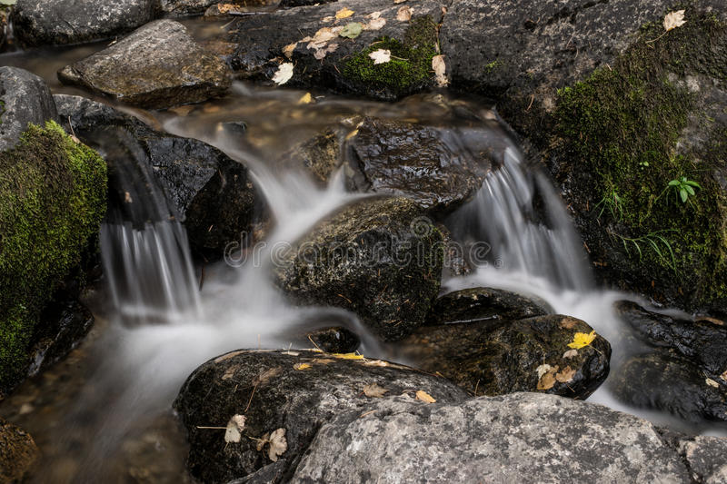 Creek flowing over rocks stock photography