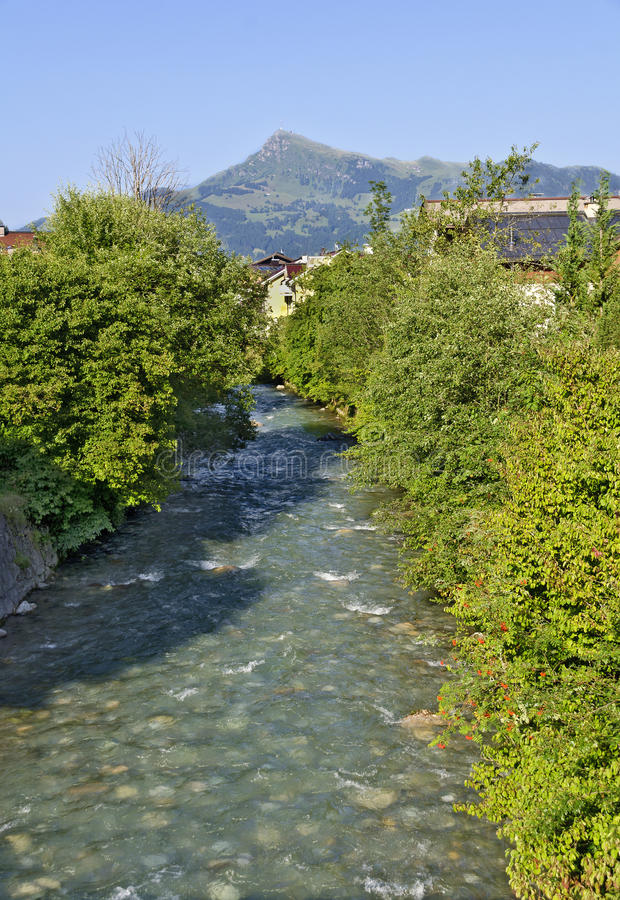 Creek Reither Ache in the village of Kirchberg stock image