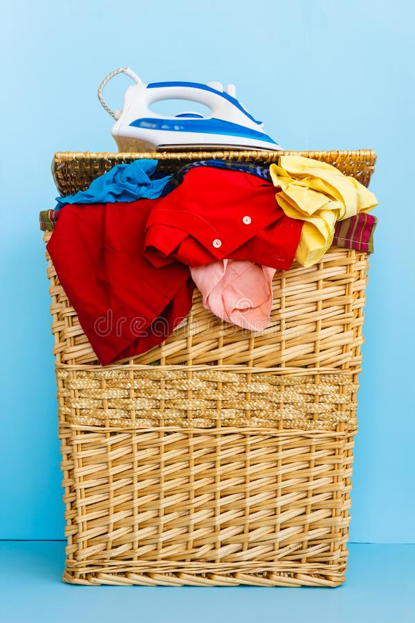 Creel of clothes. Brimfull of clothes to be ironed with a iron royalty free stock photos