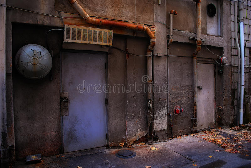 Ominous Alleyway. A creepy alley in the heart of midtown stock photo
