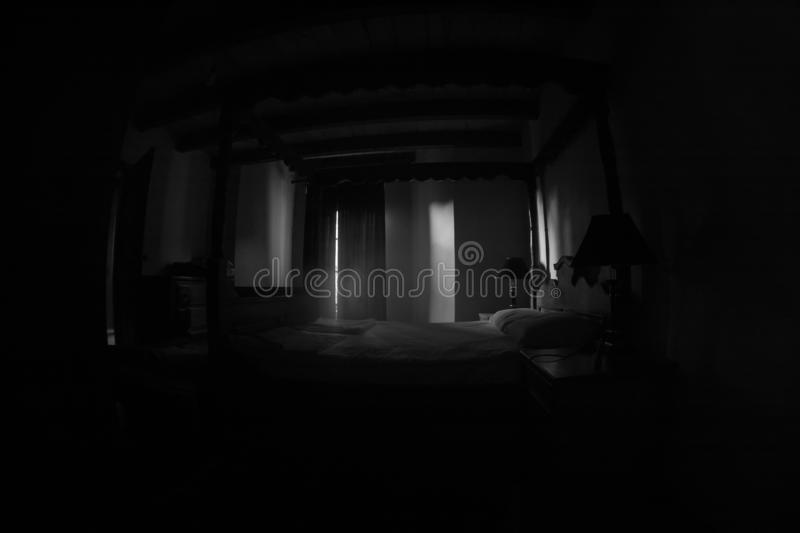 A creepy bedroom scenery, Antique scary bedroom with window and Halloween pumpkin. Horror Holiday concept. A creepy bedroom scenery, Antique scary bedroom with stock image