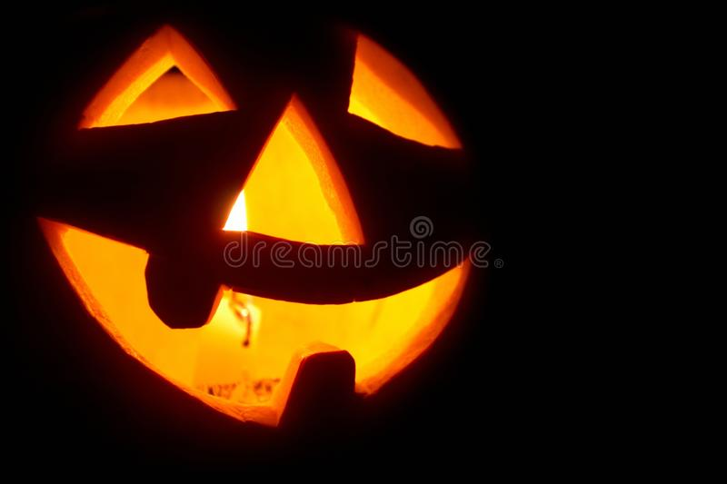Creepy carved pumpkin face stock images
