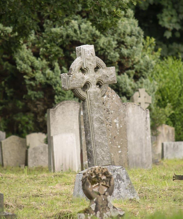 Creepy cemetery. Creepy dark cemetery with old graves stock photography