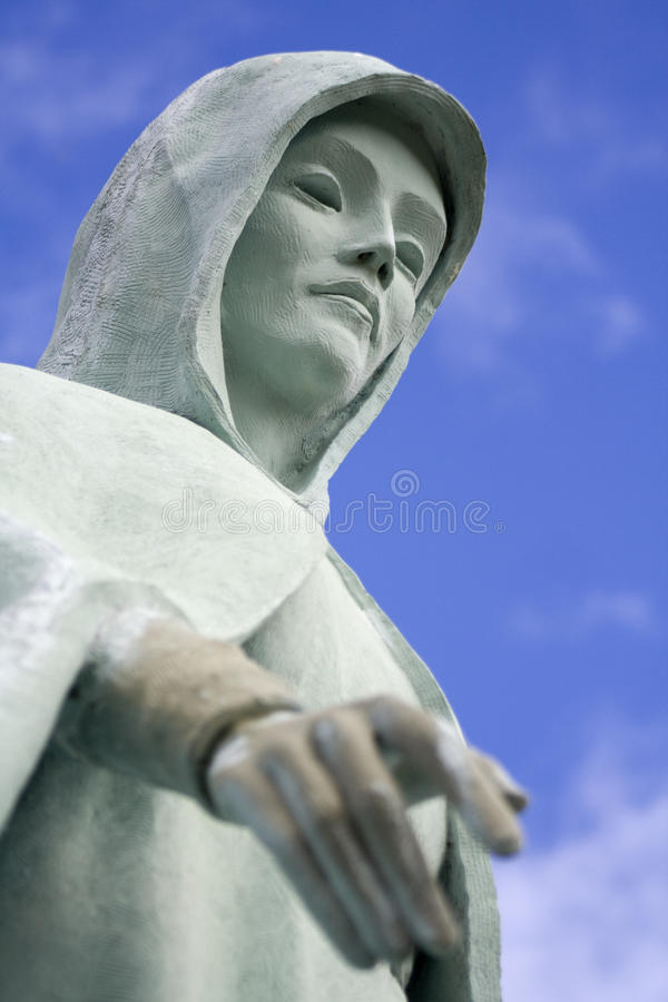 Creepy Cemetery Statue. Creepy green statue standing in a cemetery royalty free stock photo