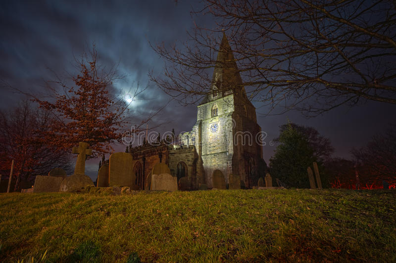 Creepy church and cemetery. Creepy church and graveyard in old fashioned england stock photography