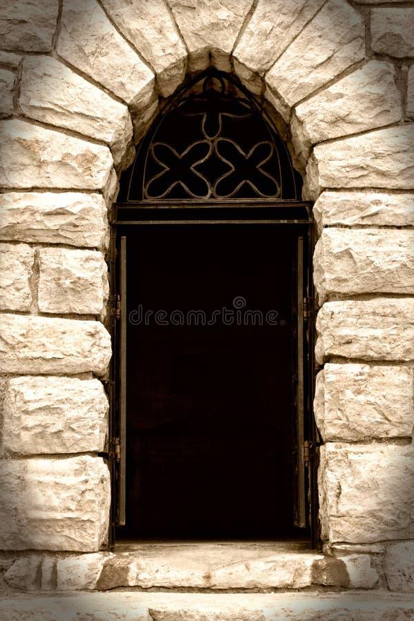 Creepy Doorway in Stone House. View of Creepy Dark Doorway in Stone House royalty free stock photography