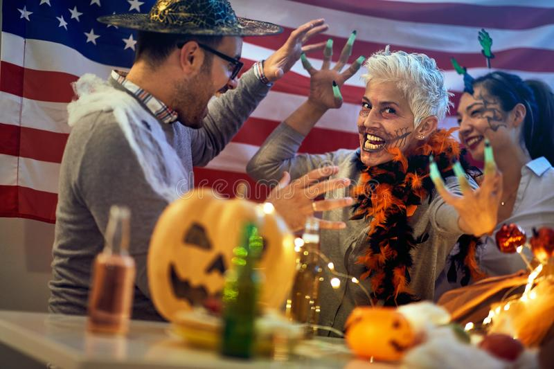 Creepy faces made by party. Woman celebrate Halloween stock photo