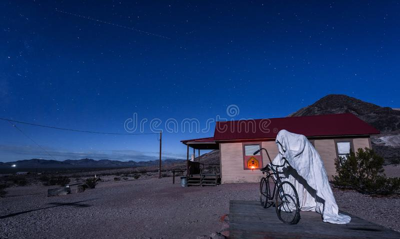 Creepy ghost sculpture installation in Rhyolite, Nevada. Rhyolite, Nevada - October 23, 2018 : Creepy ghost sculpture in Rhyolite called the Ghost Rider royalty free stock photography