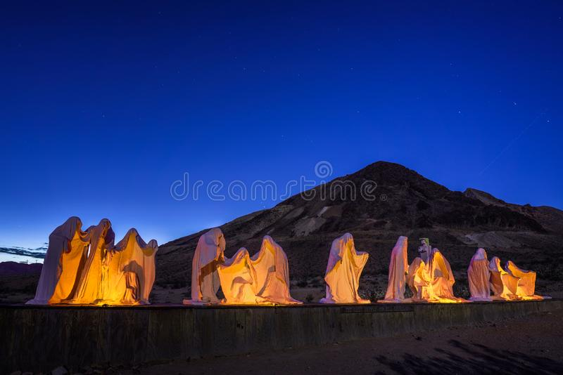 Creepy ghost sculpture installation in Rhyolite, Nevada. Rhyolite, Nevada, USA - October 23, 2018 : Creepy ghost sculptures in Rhyolite, a former mining town stock photography