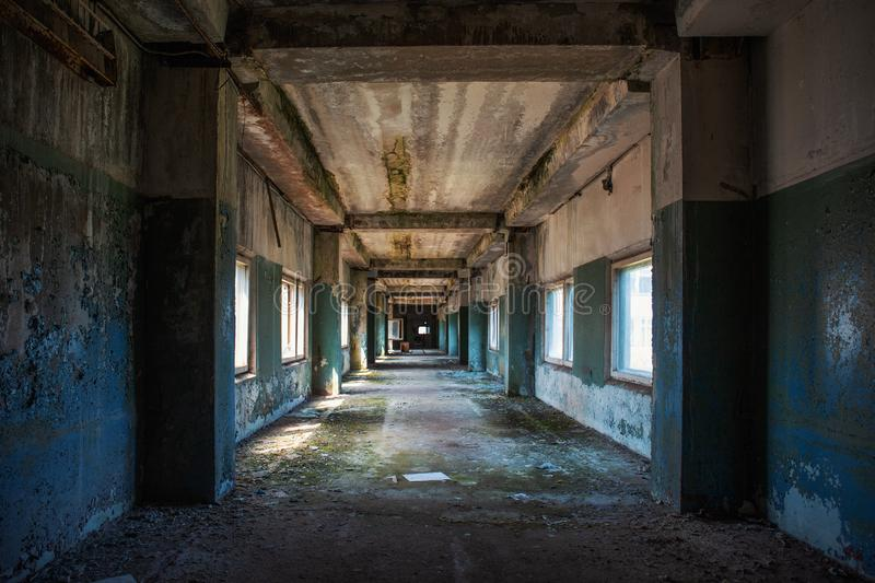 Creepy grunge tunnel or corridor in old ruined building. Way to freedom and hope concept.  royalty free stock photography