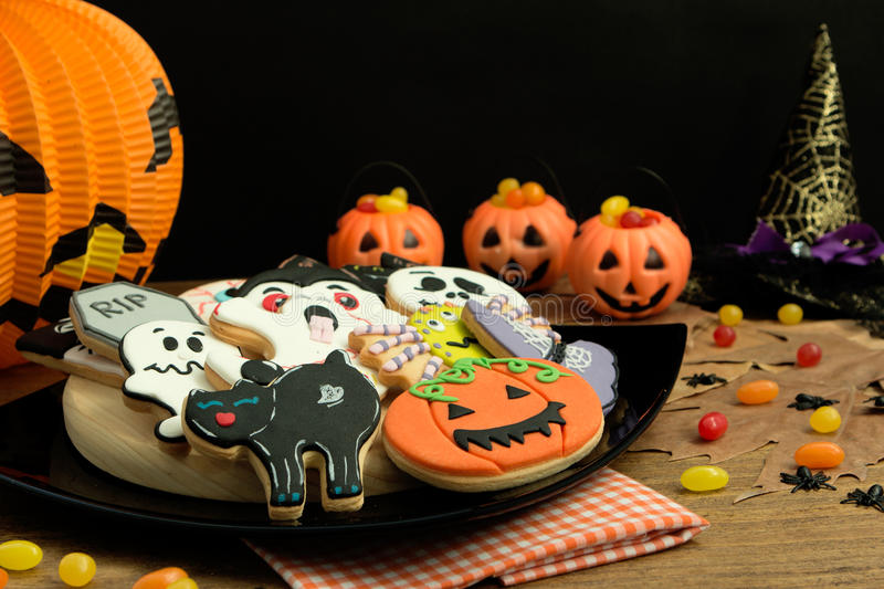 Creepy Halloween cookies and pumpkin baskets filled with candies royalty free stock photos