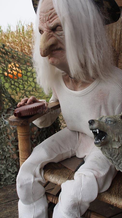 Creepy halloween figure on a chair stock photo