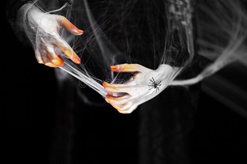 Creepy halloween hand in orange and white with spider web, zombie hand stock photos